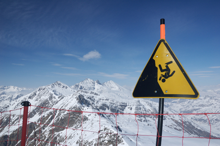 alpinist: The Alps, height mountain in winter, warning sign