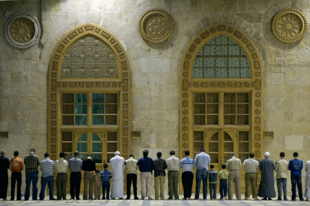 Group of Muslims praying in the mosque in Damascus