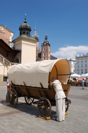 Horse cart on main squaer in Krakow, Poland