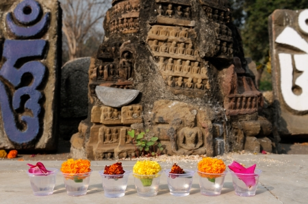 Gifts for Buddhas god in Mahabodhy Buddhist temple in Bodhgaya, Bihar, India.  photo