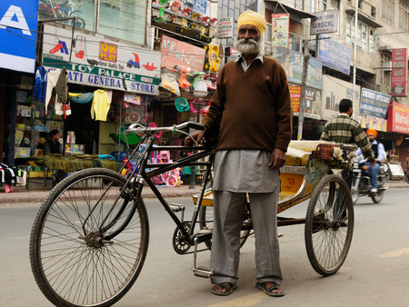 amritsar: INDIA, AMRITSAR - NOVEMBER 29  Rickshaw driver with one
