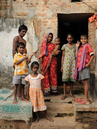 PURI, INDIA - DECEMBER 18  Indian family standing on the doorstep of its house,  Puri in December 18, 2009