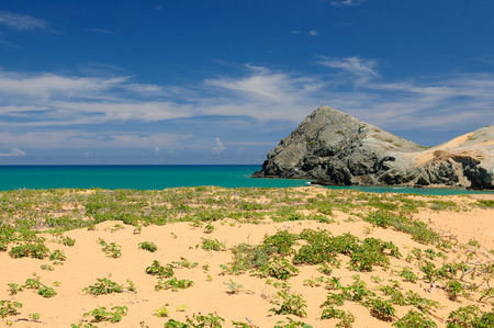 azucar: Pilon de Azucar beaches of the Caribbean coast with turquoise water and orange sand Stock Photo
