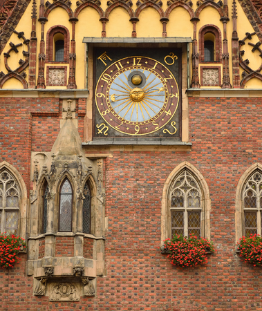 Old clock on the facade of the town hall on the main squer in Wroc�aw, Poland photo