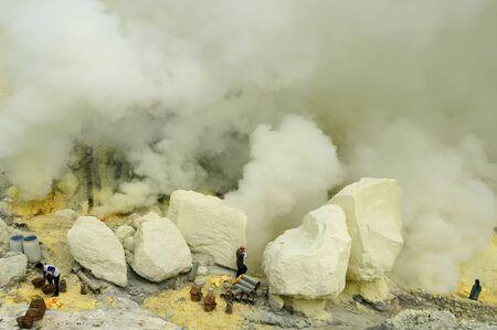 KAWAH IJEN, JAVA, INDONESIA - MARCH 28: Carriers of sulphur from the caldera Kawah Ijen volcano near Bondowoso, Baluran National Park, Kawah Ijen on March 28, 2011.
