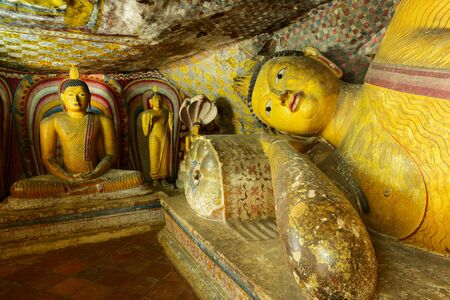 insides: Insides of caves in ancient Buddhist complex in Dambulla cave temple. Sri Lanka. The photograph is presenting the statue of lying Buddha Editorial