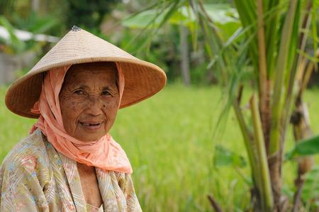 YOGYAKARTA: YOGYAKARTA, JAWA, INDONESIA - MARCH 23: Older woman in the traditional dress from the island Jawa in Indonesia, Yogyakarta on March 23, 2011