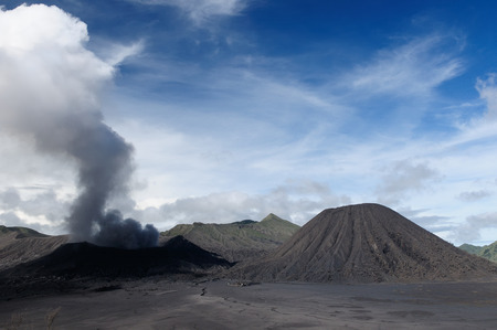 erupt: View on the Ngadisari temple built at the foot of the Bromo volcano in Indonesia on an island Jawa. Bromo - Tengger - Semeru National Park. East Jawa