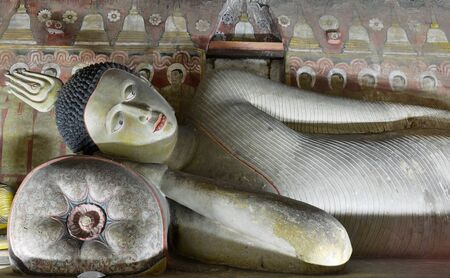 insides: Insides of caves in ancient Buddhist complex in Dambulla cave temple. Sri Lanka. The photograph is presenting the statue of Buddha