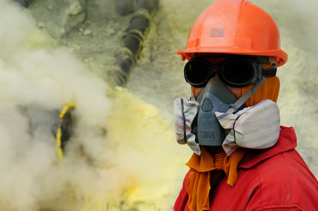 KAWAH IJEN, JAVA, INDONESIA - MARCH 28: Employee working directly in the crater of the volcano Kawah Ijen near Bondowoso, Baluran National Park, Kawah Ijen on March 28, 2011.
