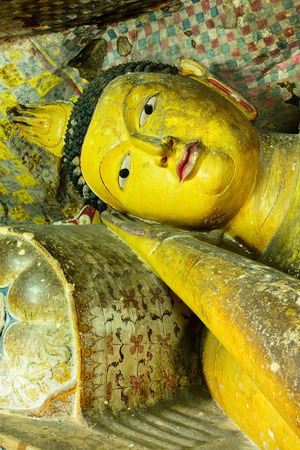 sri lanka temple: Insides of caves in ancient Buddhist complex in Dambulla cave temple. Sri Lanka. The photograph is presenting the statue of lying Buddha Stock Photo
