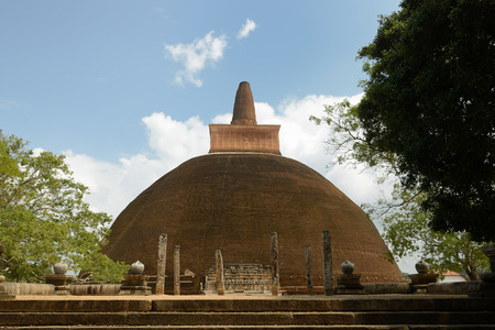 dagoba: Anuradhapura ruin, historical capital city of the Sinhalese Buddhist state on Sri Lances The photograph is presenting the Adhayagiri dagoba (stupa). Stock Photo