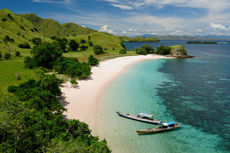 flores: Beaches with white sand and turquoise water in the national park on Komodo. Indonesia