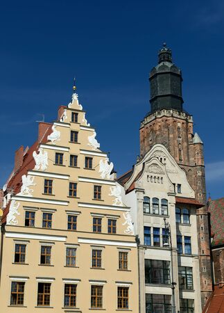Facades of colour buildings on the old square in Wroc?aw, Poland photo