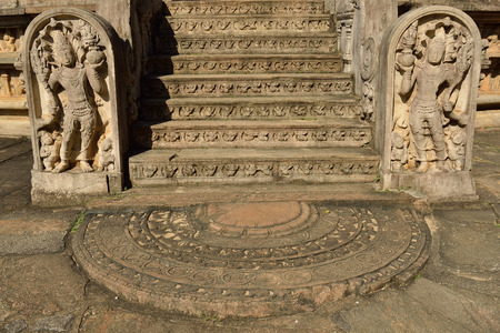 bass relief: Polonnaruwa ruin was the second capital of Sri Lanka after the destruction of Polonnaruwa. The photograph is presenting bass - relief on stairs in Vatadage (Round House). Sri Lanka Stock Photo