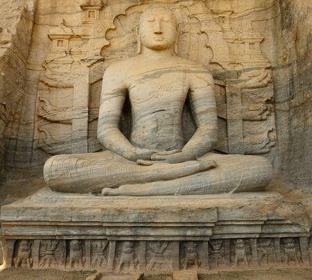 vihara: Polonnaruwa ruin was the second capital of Sri Lanka after the destruction of Polonnaruwa. The photograph is presenting  a seated Buddha sculpture at Gal Vihara. Sri Lanka