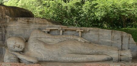 buddha sri lanka: Polonnaruwa ruin was the second capital of Sri Lanka after the destruction of Polonnaruwa. The photograph is presenting  a lying Buddha sculpture at Gal Vihara. Sri Lanka Stock Photo