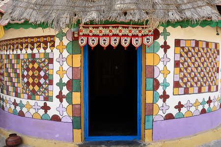 gujarat: Traditionally decorated hut in the tribal village on the desert in India in the Gujarat state