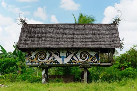 Traditional Dayak tribal culture. Detail Dayak longhouse house in the village. East Kalimantan Indonesia Borneo. Banco de Imagens