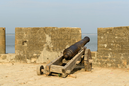 gujarat: Cannon on walls of the Portuguese fort in the Diu town in Gujarat. India Stock Photo