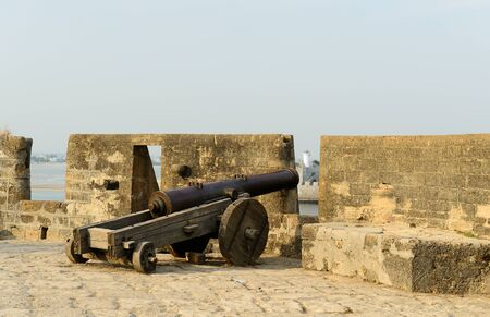 fortify: Cannon on walls of the Portuguese fort in the Diu town in Gujarat. India Stock Photo