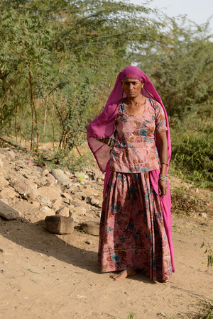 he is a traditional: BHUJ RAN KUCH OF INDIA JANUARY 13: The tribal woman in the traditional dress he is going through deserts in of Ran of Kuch in the Gujarat state in India Ran of Kuch in January 13 2015