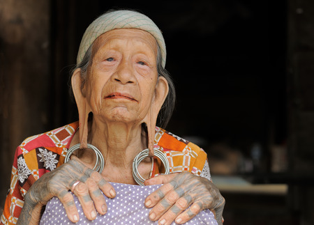 LONG BAGUN BORNEO INDONESIA JULY 07: The Dayak older women with traditional long earlobes and tattoo from Borneo Long Bagun on July 07 2011