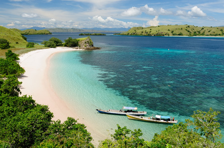 Beautiful beaches with white sand and turquoise water in the national park on Komodo. Indonesia Stock Photo
