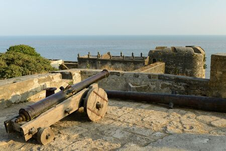 gujarat: Cannon on walls of the Portuguese fort in the Diu town in Gujarat. India Editorial