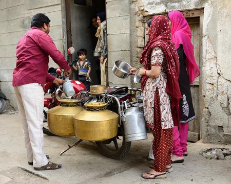 gujarat: JUNAGADH, GUJARAT, INDIA - JANUARY 17: Door-to-door seller of the milk in the Gujarat state in India, Junagadh in January 17, 2015 Editorial