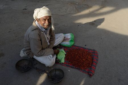 gujarat: JUNAGADH, GUJARAT, INDIA - JANUARY 17: Seller of fruits staying in the street in the Indian city in the Gujarat state in India, Junagadh in January 17, 2015
