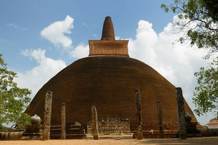 dagoba: Anuradhapura ruins, the historical capital city of the Sinhalese Buddhist state on Sri Lances The photograph is presenting the Adhayagiri dagoba stupa.