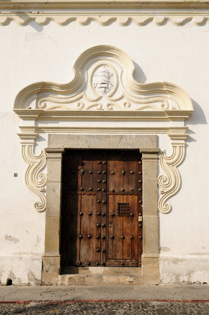 colonial house: Entry to the colonial house in in the Antigua town in Guatemala, Central America Editorial