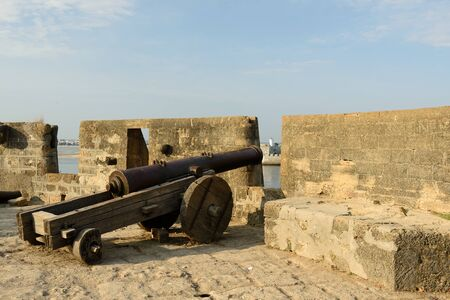 garrison: Cannon on walls of the Portuguese fort in the Diu town in Gujarat. India Stock Photo