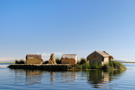 buoyant: Floating Uros islands on the Titicaca lake, the largest high-altitude lake in the world 3808m. Theyre built using the buoyant totora reeds grow That abundantly in the shallows of the lake, Peru Stock Photo