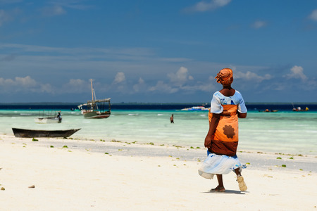 Ethnic women on the beautiful beach on the  Zanzibar island, Tanzania, Africa