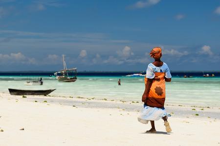 Ethnic women on the beautiful beach on the  Zanzibar island, Tanzania, Africa