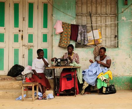 IRINGA, TANZANIA - APRIL 20: African women sewing clothes in streets in Tanzania, Iriga in April 20, 2013