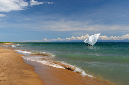 tanganyika: Tanganyika lake  is the Worlds longest and second deepest fresh water lake, it is also one of the oldest lakes on the planet. The picture presents beautiful sand beach, Tanzania