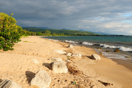tanganyika: Tanzania, Malawi lake is the Worlds longest and second deepest fresh water lake, it is also one of the oldest lakes on the planet. The picture presents beautiful sand beach and traditional dugout canoe Stock Photo