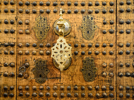 unusually: Detail of unusually ornamented Moroccan architecture. Knocker to the door Stock Photo