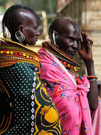 indigent: MARARAL, KENYA - JULY 04: African woman from the Turkana tribe on the market in the Mararal town in Kenya, Mararal in July 04, 2013