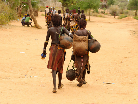 african village: Local Ethiopian people coming back from the market from the Turmi village in the Omo valley in Ethiopia