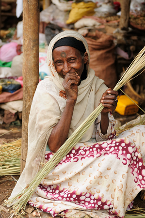 neckless: BAHYR DAR, ETHIOPIA - AUGUST 12: Portrait of the woman weaving baskets on the market in Bahyr Dar in August 12, 2013