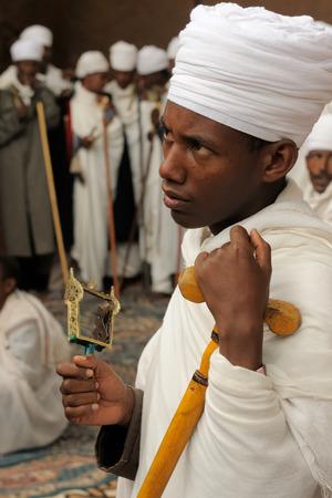 ade: LALIBELA, ETHIOPIA - AUGUST 30: Ethiopian pilgrim is praying in the complex of temples in solid rock in Lalibela, Ethiopia in Lalibela in August 30, 2013