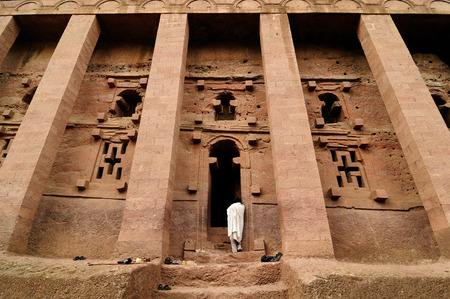 faade: Ethiopian pilgrim is praying in the complex of temples in solid rock in Lalibela, Ethiopia