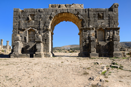 pilaster: Extensive complex of ruins of the Roman city Volubilis - of ancient capital city of Mauritania in the central part of Morocco by the Meknes city. The photograph presents arc de Triomphe de Caracala Stock Photo