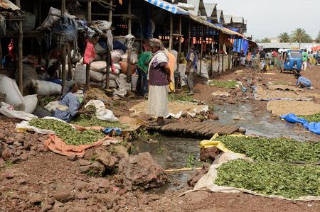 neckless: BAHYR DAR, ETHIOPIA - AUGUST 12: Woman selling vegetables on the threshing floor on the market in Bahyr Dar in August 12, 2013