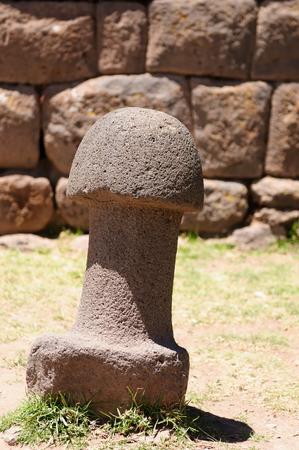 phallus: South America, Inca prehistoric ruins in Chucuito near Puno, Titicaca lake area. This photo present stone phallus in temple de la Fertilidad, Peru Stock Photo