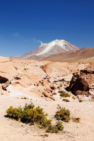 surreal landscape: South America - The surreal landscape in the Eduardo Avaroa National Reserve of Andean Fauna near Chilean border. The picture present volcano Ollague